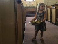 One of our littlest ushers