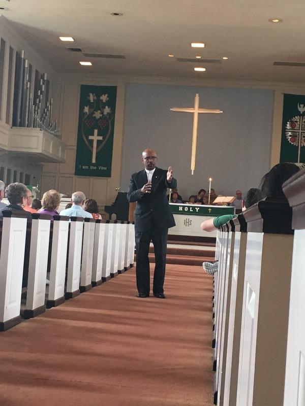 Pastor Alex taking prayer requests.