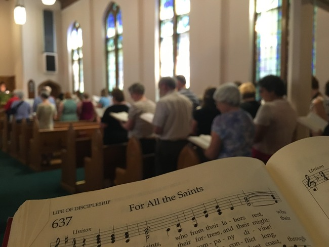 "Singing, ""For All the Saints"""
