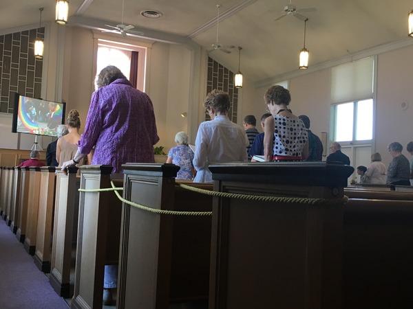Singing at the close of worship.