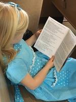 Reading the bulletin.