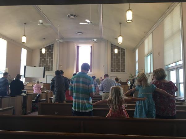 Singing during worship.