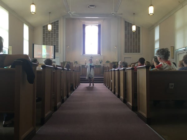 Pastor Nancy preaching.