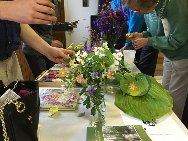 Making flower arrangements with fresh picks from our gardeners.