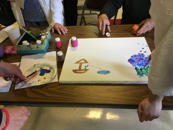 Painting water scenes together.