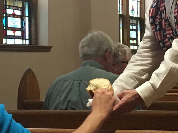 Breaking bread for communion.