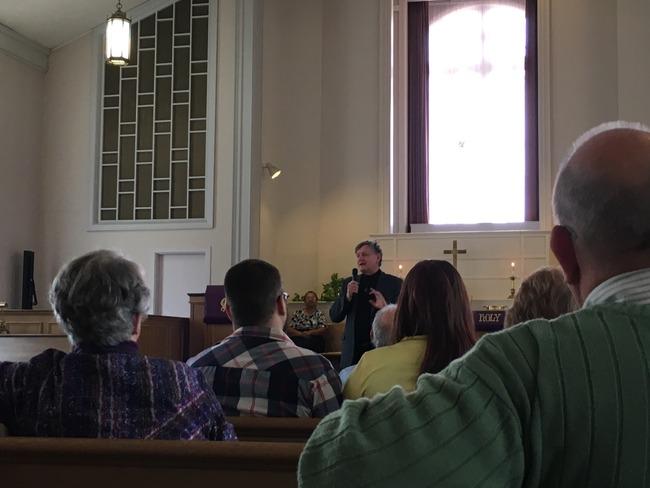 John Conway preaching.